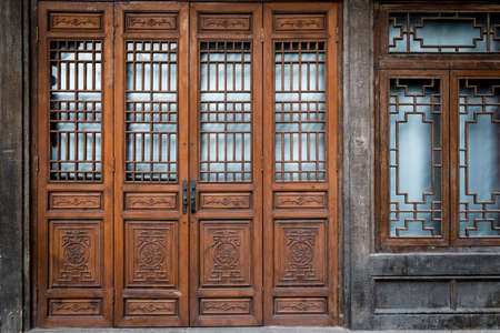 chinese traditional house: Old and traditional Chinese folding doors.