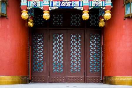 Traditional Chinese gateway with folding doors. photo & Traditional Chinese Gateway With Folding Doors. Stock Photo ...
