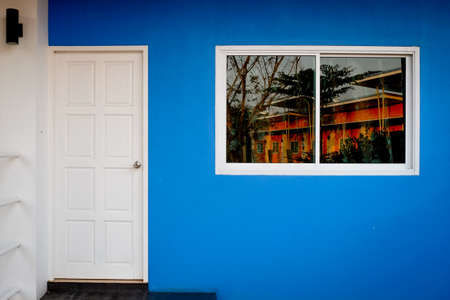 Vibrant color wall with door and windows.