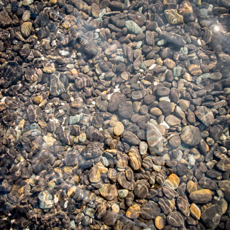 water s edge: Natural stone under seawater for background. Stock Photo
