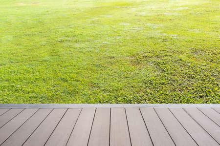 Grass field by the terrace. Stock fotó