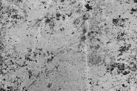 Abstract rugged concrete texture in black and white.