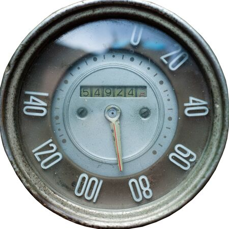 old retro speedometer from car, vintage mechanical speedometer on white isolated background close-up