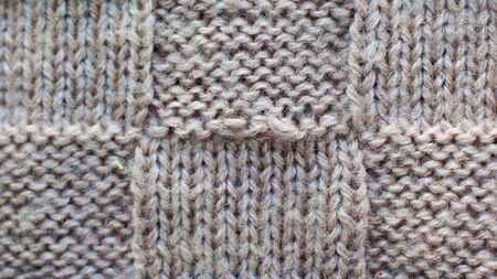 Gray background of knitted yarn, texture pattern knitted fabric close-up