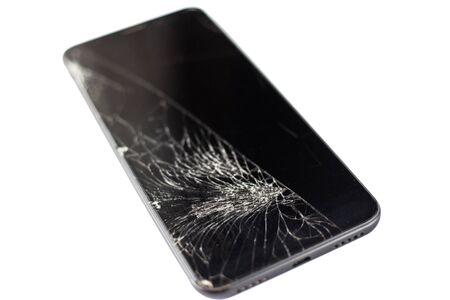 black phone with a broken sensor and screen, cracked touchscreen glass on a white background isolate close-up