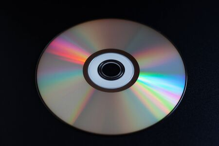 rare CD with music on a dark background close-up