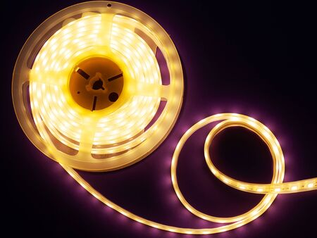 LED strip on a dark purple background, diode light close-up Imagens