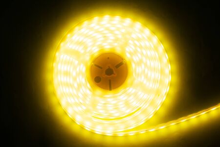 beautiful glowing LED strip of warm light for mounting decorative lighting for homes, offices and other dark places close-up Stock Photo