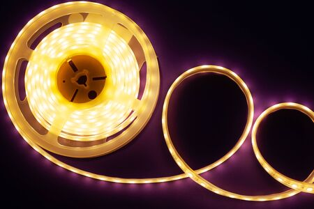 LED strip on a dark purple background, diode light close-up Stock Photo