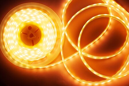Silicone diode tape for lighting decorative corners and niches, LED light coil close-up