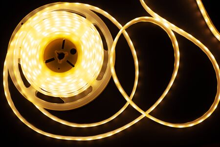 luminous tape for interior lighting,led coil on a dark background close up