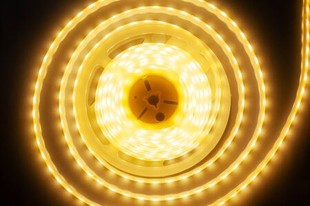lighting led tape,diode tape warm spectrum,round glowing garland close-up Stock Photo