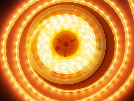 LED tape, decorative light orange in a round diode tipe, rgb strip coil close-up