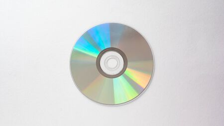 CD on a light gray background close-up