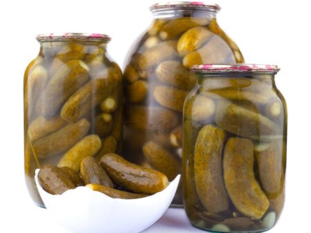 salted cucumbers in jars isolated, pickled gherkins close-up Banco de Imagens