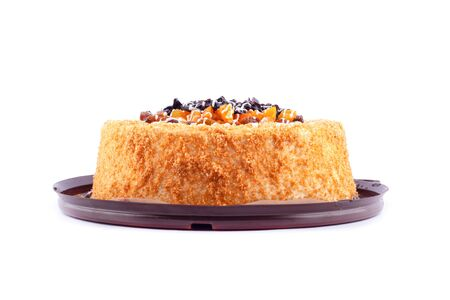 beautiful homemade cake with dried apricots and prunes on a white background isolated close-up