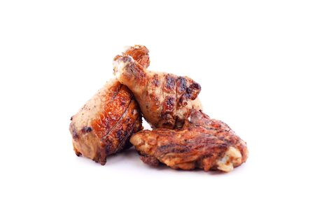 fast food grilled chicken   legs to a crust  on a white background isolated close-up