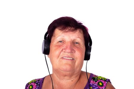 Smoked grandmother listens to music on headphones isolate close-up Stock fotó