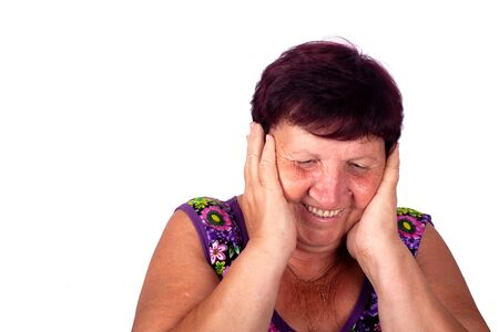 satisfied grandmother covers ears with her hands and laughs ,old woman holds head and laughs isolated close-up