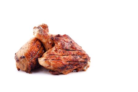 grilled chicken  thighs and drumsticks on a white background,isolated close-up