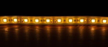 Concept: Luminous diode strip. Decorative LEDs technology closeup Фото со стока