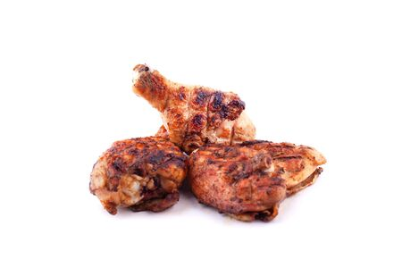 grilled chicken legs on the grill isolated. Stock Photo