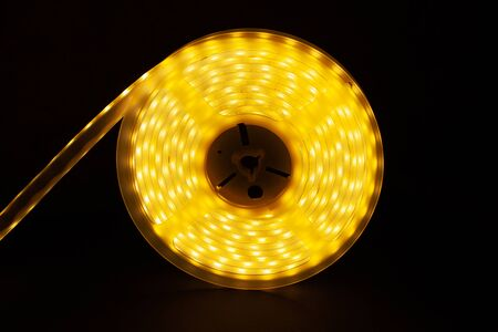 Warm LED Strip Light.diod tape coil closeup. Stock Photo