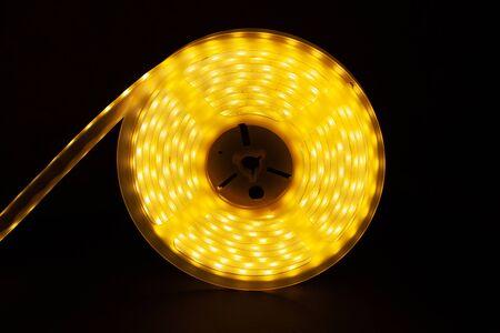 Warm LED Strip Light.diod tape coil closeup. Фото со стока