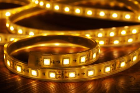 Led silicon shining strip in coil.Line diode lights closeup Фото со стока