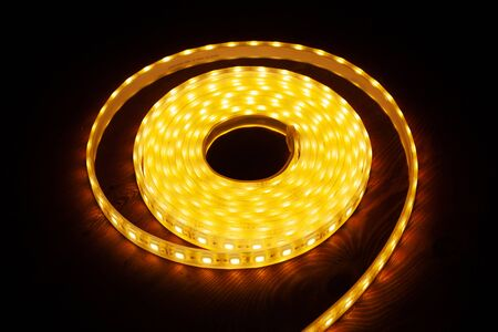 Led silicon shining strip in coil. Diode orange lights closeup