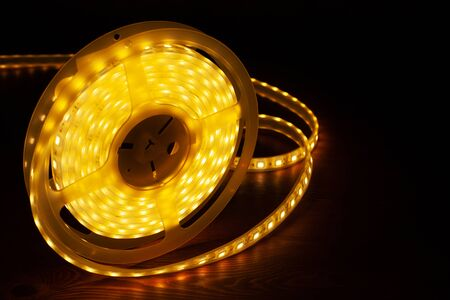 Led silicon shining strip in coil. Diode lights closeup.Decorative lighting Фото со стока