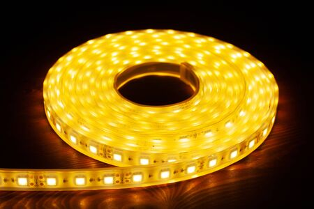 Led silicon shining strip in coil. Diode lights closeup.Electrotechnology concept.