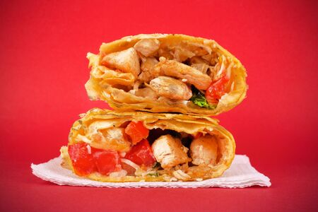 Fast food concept : chicken shawarma on a red background closeup Stock Photo - 129841391