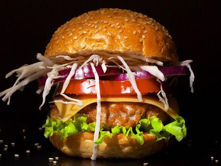 fresh tasty burger on black background closeup Stock Photo - 129841404