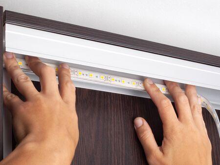 process installation of decorative led lighting closeup Stock Photo