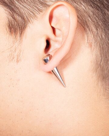 ear piercing tunnel extension  close up.