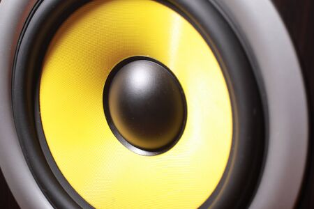 yellow subwoofer speaker,concept: loud music closeup. 写真素材