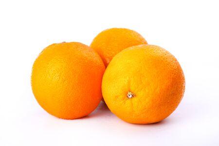 freshly picked citrus fruit on white background,3 Juicy Sweet Oranges.