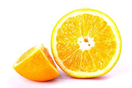 half and slice of sliced orange on a white background closeup. Stock Photo