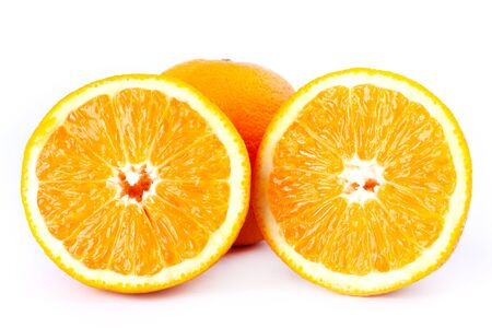 cut oranges in half on a white background closeup.