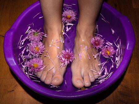 fragrant flower foot bath at night Asian spa salon.