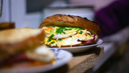 sandwiches with egg,cheese and green onion. homemade hot sandwich.