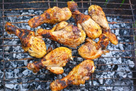 grilled chicken legs on the grill top view. Reklamní fotografie