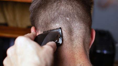 trimming hair in a barber shop, men's hairdresser.