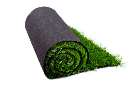 roll with green artificial lawn, coating isolated on white background.