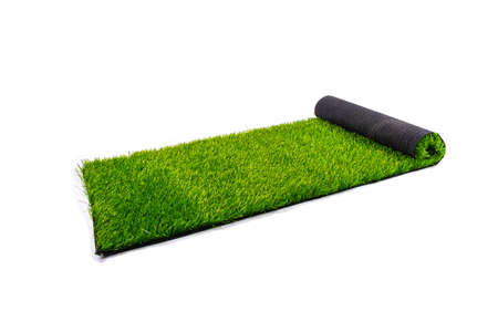 roll with artificial green lawn isolated on white background, covering for playgrounds and sports grounds. 免版税图像