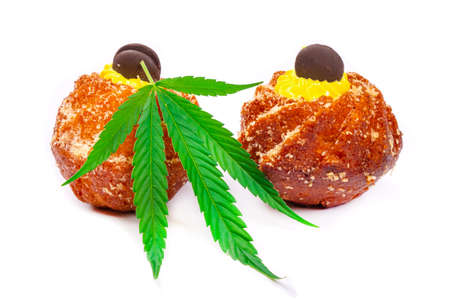 sweet fresh muffins with cannabis oil, sweets with marijuana isolated on white background.