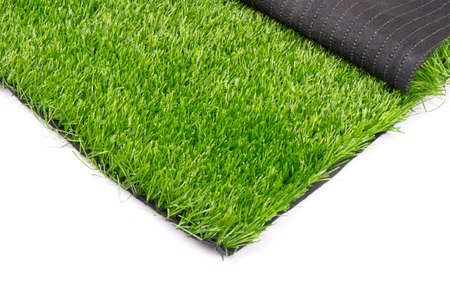 plastic green grass isolated on white background close up.