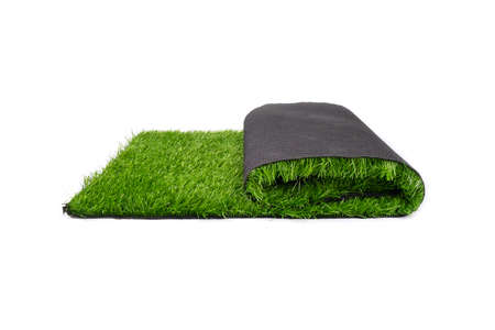 roll of artificial plastic green grass isolated on white background. 免版税图像