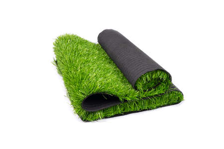 roll of artificial green grass isolated on white background, covering for playgrounds and sports grounds.
